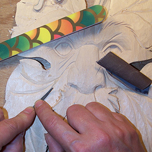 smoothing stage of wood carving