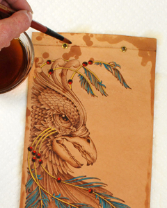 painting a leather pyrography pattern