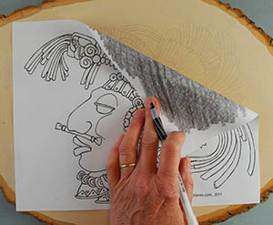You can trace your pattern using carbon paper, graphite paper, or a pencil rubbing.