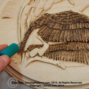 How to use wood burning in your wood carving relief projects by Lora Irish