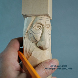 carving the wrinkles of a wood spirit face