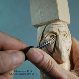 using a small round gouge in wood carving