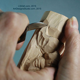 shaping the msutache of a wood spirit