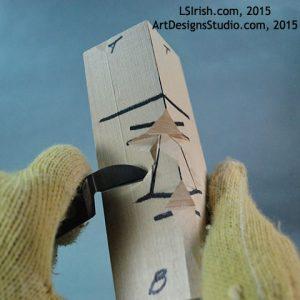 cutting the cheek line of a wood spirit face