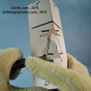 cutting the cheek of a wood spirit