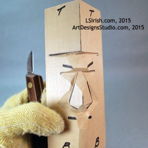 Cutting the wood spirit walking stick