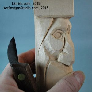 carving the eye lids of a wood spirit