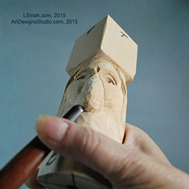 cutting the nostrils of a wood spirit nose